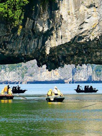 rowing boat cruising halong